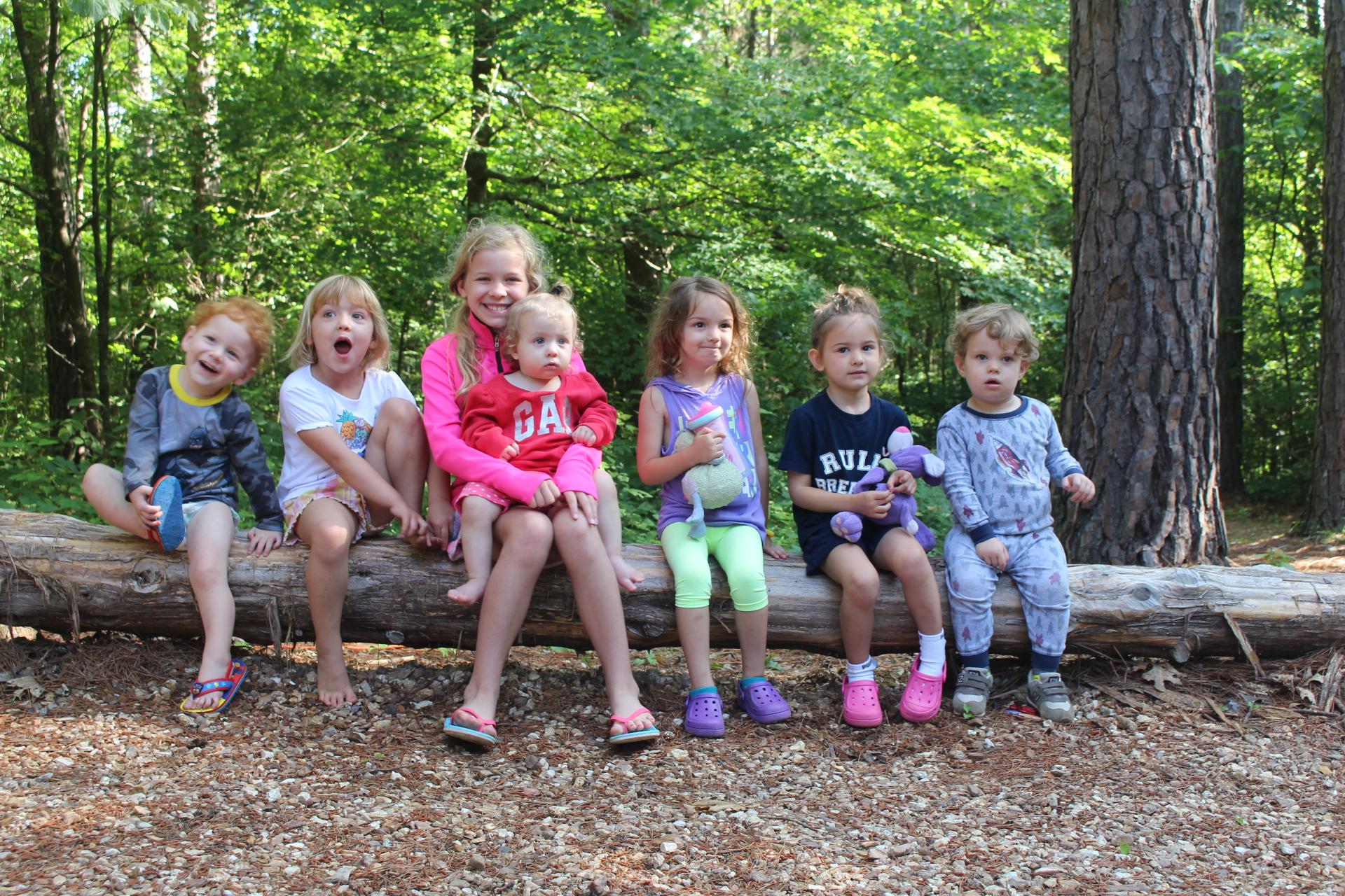 7 kids on log